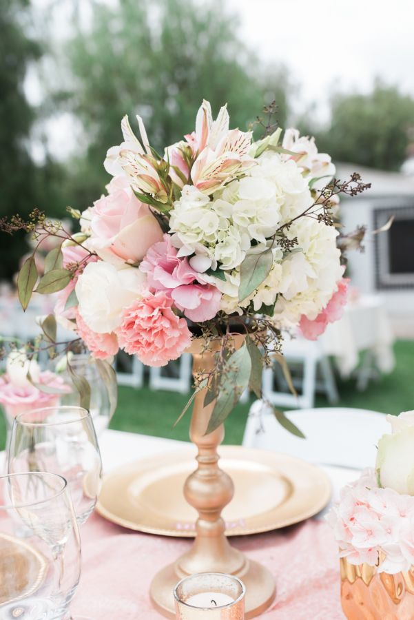 Hydrangea, carnation, and rose centerpiece: http://www.stylemepretty.com/california-weddings/corona/2016/10/24/california-pastel-pink-wedding/ Photography: Hello Blue - http://hellobluephoto.com/