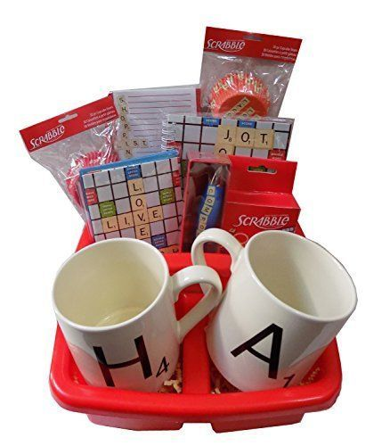 """Celebrate the game of Scrabble with this Scrabble Lovers Gift Basket Basket Includes: 2 Scrabble Piece Mugs, 2 Sets of Cupcakecake Liners - """"Celebrate"""" and """"Live, Love, Laugh"""", Box of Adhesive Bandages, Clicker Pen, Shopping List Notepad, Journal, and 8 Notecards with Envelopes - """"Live, Love, Laugh"""" and """"Best Wishes"""" Please utilize the free personalized message at checkout! We will ship this directly to your gift recipient!! We ship all orders the same day they are received as long as it is…"""