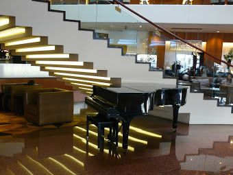Stairs and piano in the Four Seasons lobby. Use these stairs or the elevator to visit level 3 for Giulians Fine Jewellery, Phillipe Xavier hairdressing and Endota Spa.