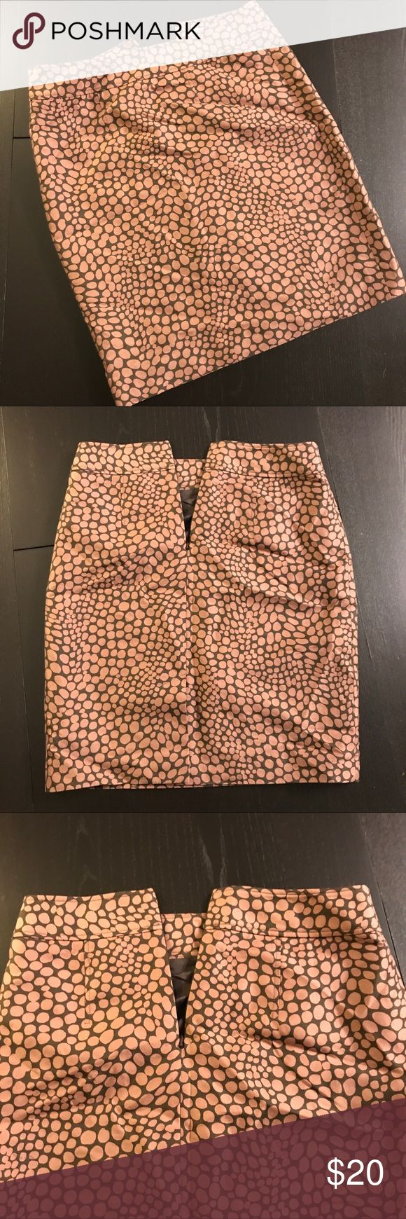 Stylish & Unique Business Skirt Great skirt to make your work wardrobe more fun! The dots are a pinkish-brown color. Lined with brown fabric/slip.  Length of skirt is 21 inches. In very good used condition. From a smoke-free home. LOFT Skirts