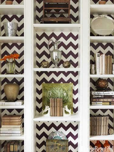 Use wallpaper, contact paper, or paint to jazz up your shelving units