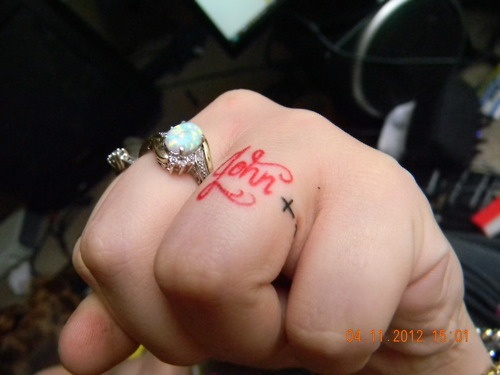 """""""This is a tattoo of my husband's name. We decided to get them because he works out of state a lot and usually can't wear his wedding band. I'm glad we got it done also because our wedding rings were stolen the very next day. In a mall parking lot… It was done by Mindy Crow-Levin at Natural Mystic in Natchitoches, Louisiana. She is a great artist and I would recommend anybody see her."""" (Love this idea!): Work, Wedding Band, Tattoo Rings, Band Tattoo, A Tattoo, Wedding Rings, Ink"""