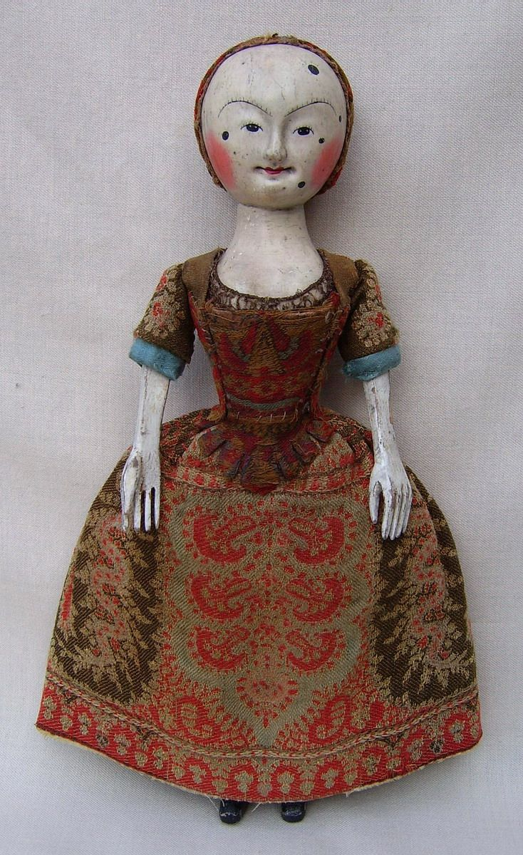 "Work of David Chapman & Paul Robinson of the ""Old Pretender"" wooden doll workshop."