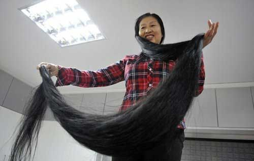 This woman is going to get her hair cut - probably the longest hair in the world...