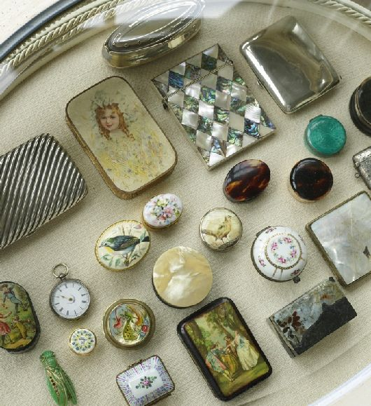 Small antiques such as pill boxes, pocket watches or vesta cases look stunning arranged in a French-style display table.