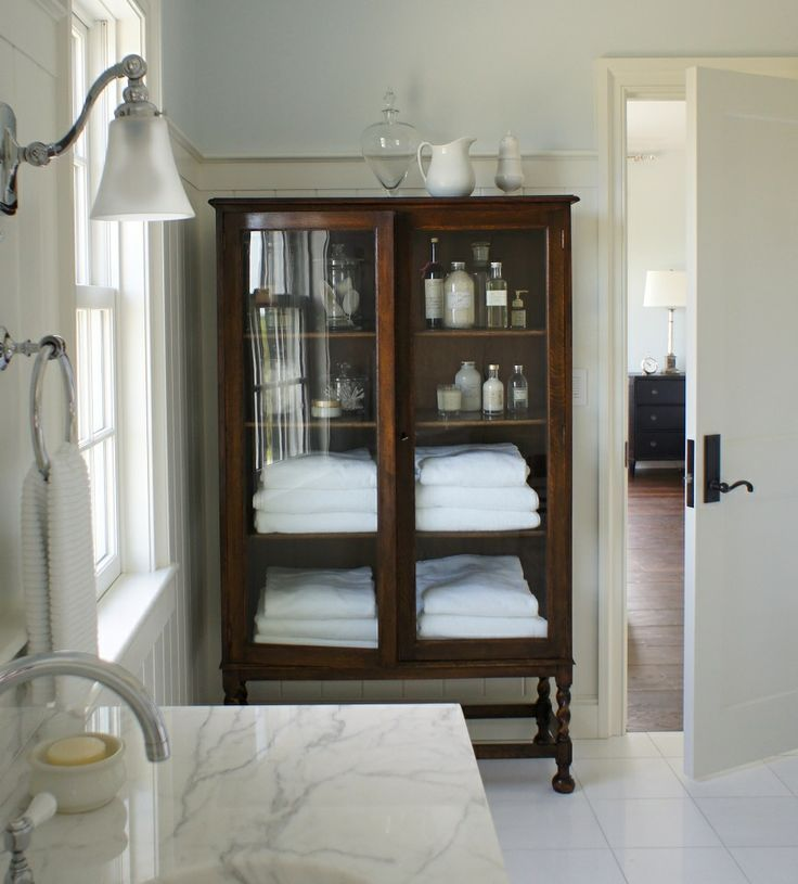 Mom has similar cabinet. Linens or towels? Painted or keep the similar stain like this?