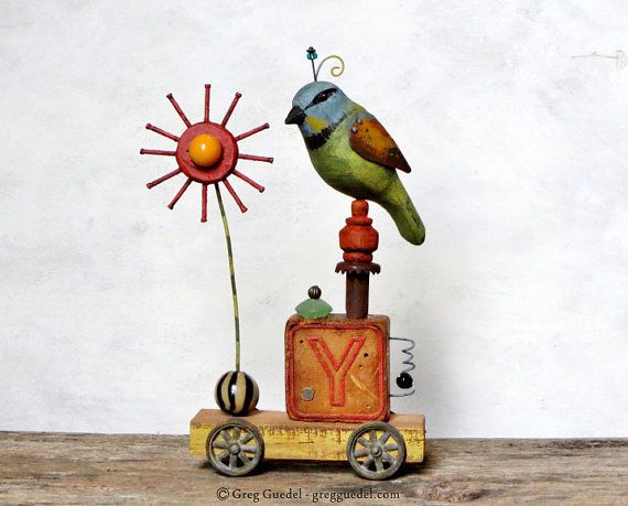 Folk art assemblage with carved wood bird and flower by GregGuedel