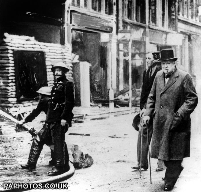 Prime Minister Winston Churchill surveys bomb damage to the capital inflicted by the German Luftwaffe during the blitz.  1940