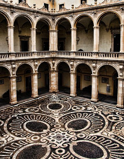 The internal courtyard of the old building of Catania University, Catania, Sicily
