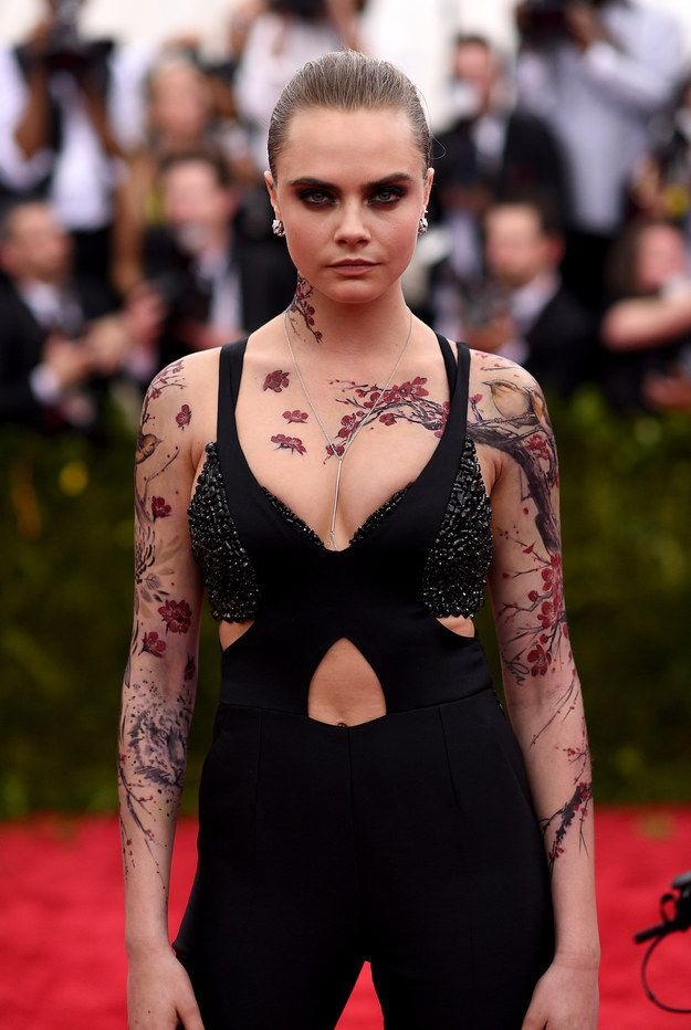 Oh, and her chest was covered in cherry blossoms, too. | Cara Delevingne Wore Full Tattoo Sleeves To The Met Gala