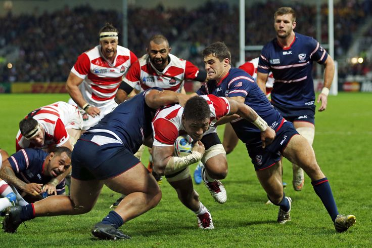 Japan's Amanaki Mafi scores a try against the U.S. during the final pool stage match of the 2015 Rugby World Cup. | REUTERS