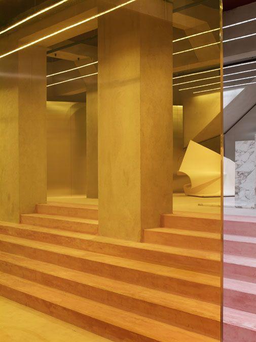superfuture :: supernews :: paris: acne store opening  jonny johansson gold-hued wall panels distort image beyond