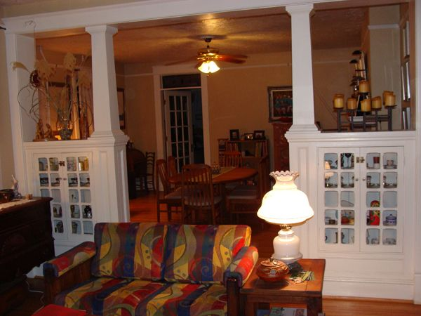 craftsman style dividers- love the color, the straight columns and glass fronted cupboards