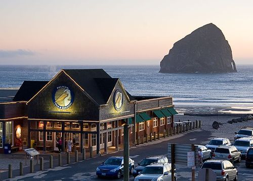 View of the Pacific Ocean, Haystack Rock, and the Pelican Brewpub from our room at the Inn at Cape Kiwanda, Pacific City, Oregon