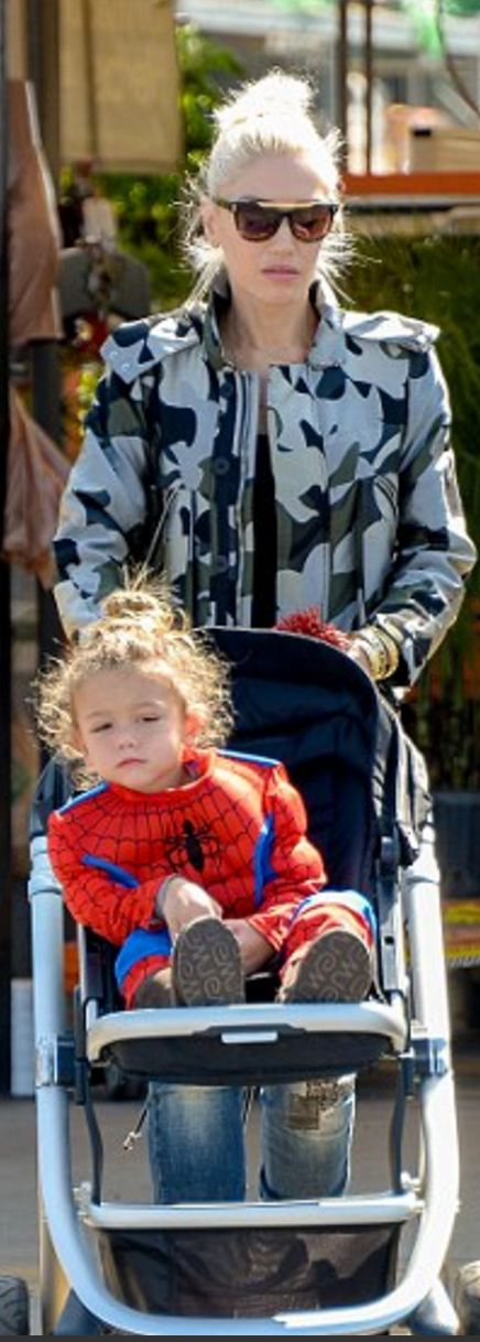 Gwen Stefani in Jacket – Whistles  Wallet – Christian Louboutin