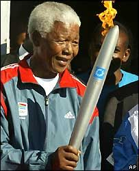 Nelson Mandela holds the Olympic Torch on Robben Island, South Africa