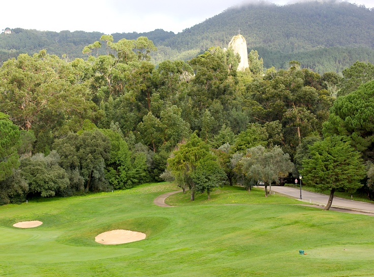 Dec 18, 2012. A beautiful setting for golf in The Ritz Carlton Penha Longa, Portugal. This is the hole number 4. In the back it is possible to see the tall rock (Penha Longa) which inpires the name of the ancient monastery.