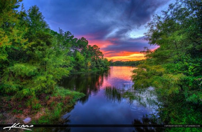 Sunset at a small Lake in Abacoa in Jupiter Florida with nice color reflection. HDR image created using Photomatix Pro and Topaz software.