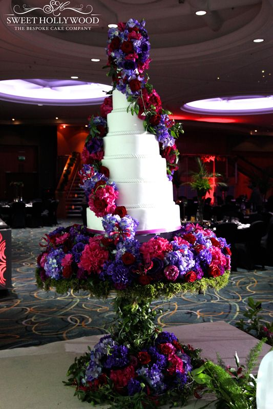 Sweet Hollywood created a grand 7 tier wedding cake that featured a double floral twist and stood on our custom floral table. Whilst the cake looked absolutely stunning we put our twist on things with a custom rotating table top that beautifully displayed the cake as the centrepiece of this magnificent Asian wedding that took place in London.