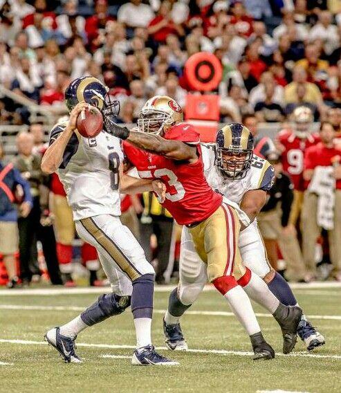 NaVorro Bowman sacks Rams QB Sam Bradford - photo by Terrell Lloyd
