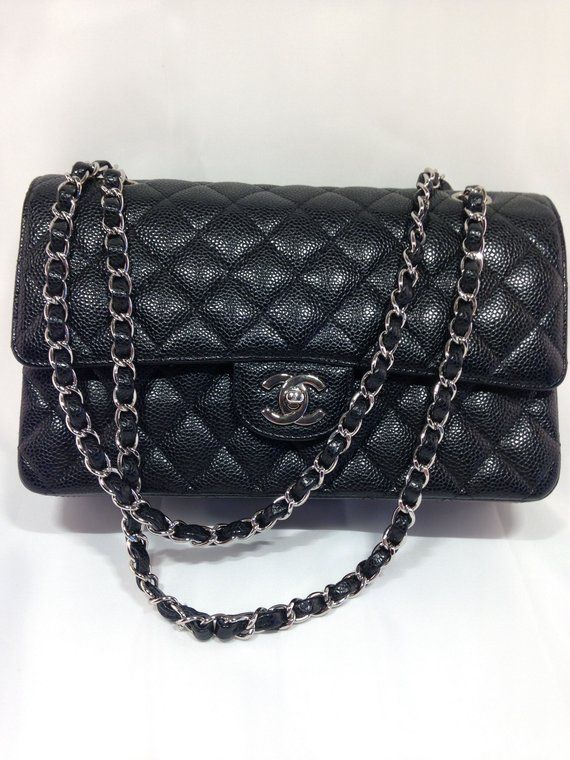 0a635500ded39 Guarenteed authentic Chanel Medium Classic Double Flap Bag in Black Quilted  Caviar Leather with Silver Tone Hardware. Chanel Classic Double Flap Caviar  ...