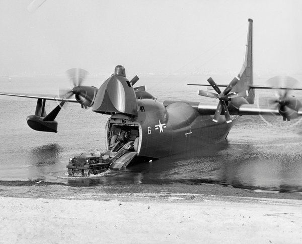 Last of the Great Flying Boats. Proving its amphibious capability, a Tradewind disgorges a Marine Corps vehicle and driver onto the San Diego beach during tests ca. 1956