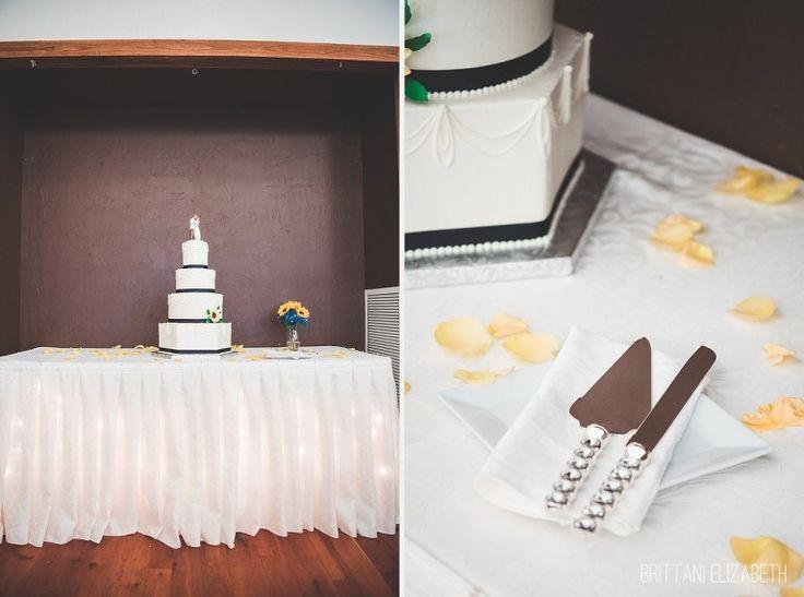White and Navy Blue Ribbon Wedding Cake | Four Tiered Cake | Yellow Rose Petals | Wedding Cake