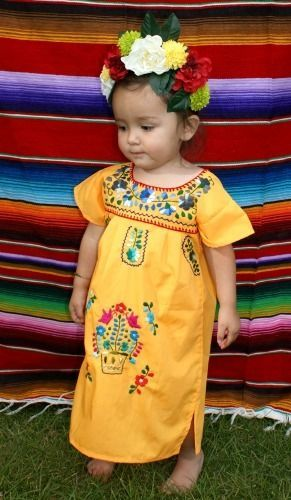 Marigold yellowSize: 12 months to 18 months  Traditional Puebla Mexican DressHandmade Embroidered Each dress has a unique pattern, color and fit. Here are a few examples of what we carry. Light weight CottonMade to be worn loose and at least knee length