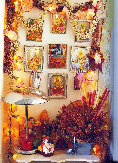 altar with garlands and frames hindu hand meditate