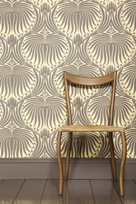 trad wallpaper with modern furniture; note gray tones...