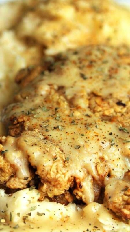 Chicken Fried Steak Recipe ~ The steak is tender and well seasoned with a perfectly golden brown crispy crust.  The gravy is yummy too with its bits of onion, garlic and spice.