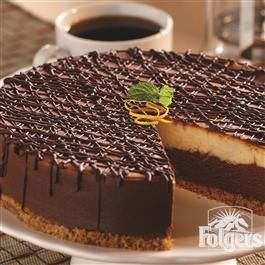Orange Mocha Latte Cheesecake A KEEPER. STOP, LOOK NO FURTHER. A GREAT DESSERT TO TRY. YOU WILL LOVE THE CHEESECAKE MIXED WITH THE CHOCOLATE LAYER. THE COFFEE JUST BRING OUT THE RICHNESS OF THE CHOCOLATE. A MUST TRY. YOU WILL LOVE THIS...ENJOY