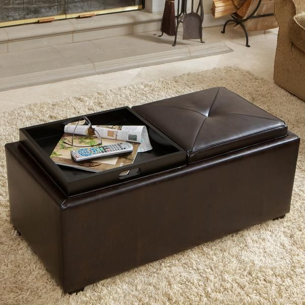 The Kenwell is a convenient piece for your serving and storage needs. Upholstered with rich bonded leather, this ottoman has a double sided top that can be flipped to reveal two separate trays. The tr