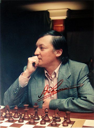 Anatoly Karpov has visited Western countries on many occasions, but as a true Soviet Guy, he could never adapt to Capitalism. In his heart the boardroom full of corporate stiffs would never substitute for the millions of true chess enthusiasts. His heart forever remains in the Soviet Union under Brezhnev's stagnant leadership...