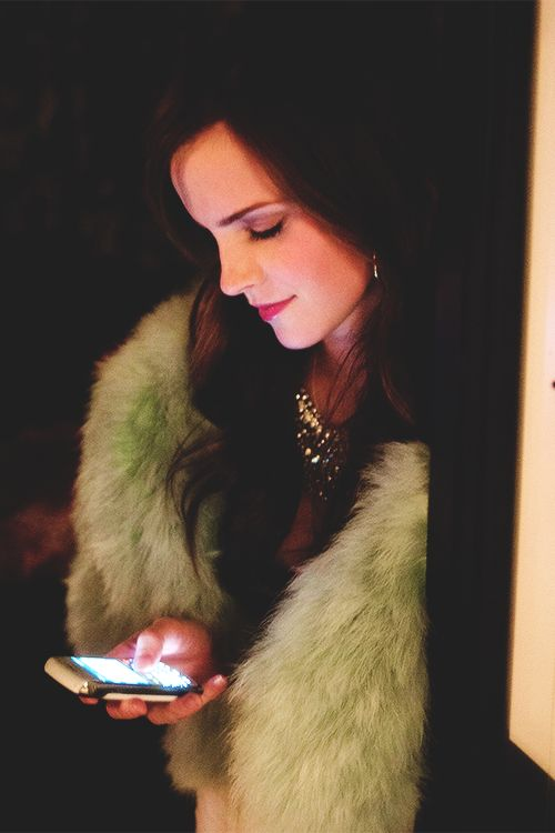 Emma Charlotte Duerre Watson checking her Ipad for recent tweets...