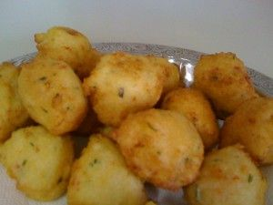 Bolinhos de Arroz, (Rice Fritters)  These are unbelievably rich in flavor and perfect for snacking on or serving as a side. These are very popular as street food and vendors and can be seen all over Brazil. They are quite simple and easy to make and you will surely love them! .