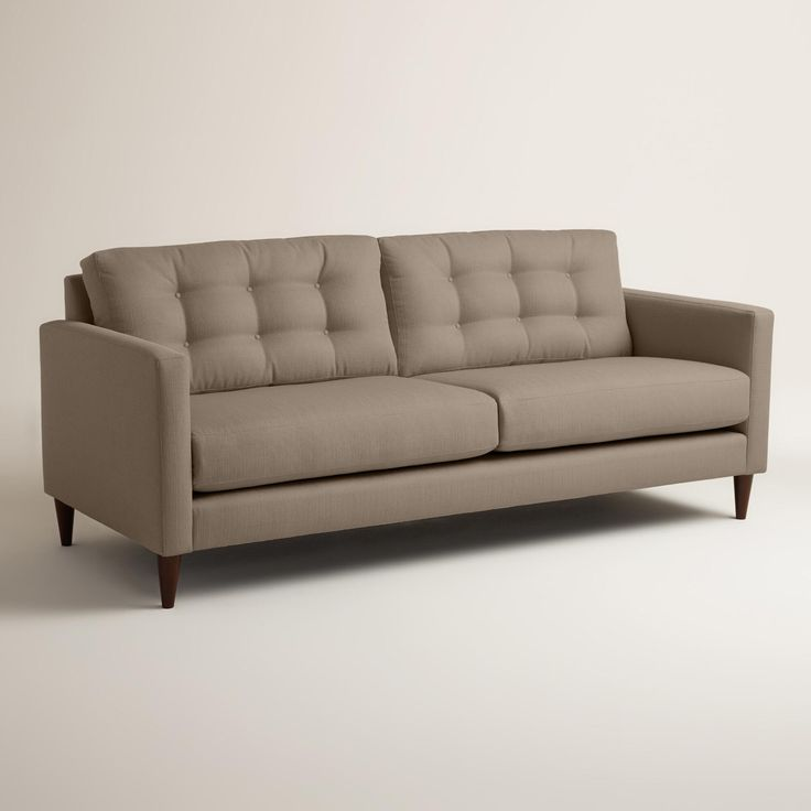 Handcrafted in the U.S.A., our custom-made sofa boasts a slim, contemporary profile with straight arms, tufted buttons and tapered cone legs in a rich walnut finish. This affordable seat features soft woven fabric upholstery, sinuous springs for added comfort and reversible cushions.