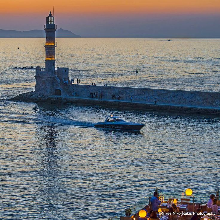 Chania: View of the Venetian lighthouse after the sunset.  The jewel of the city is one of the oldest lighthouses in the world. Happy weekend!