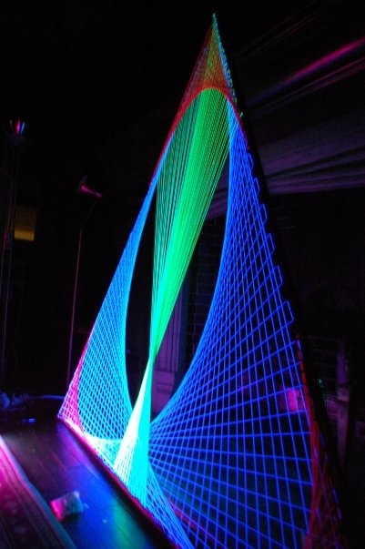 UV sculpture - awesome. Just make a triangle out of wool and wind round some UV wire. Great for parties etc.