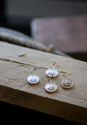 Sail away with these precious little sailboat earrings by MLAVI.