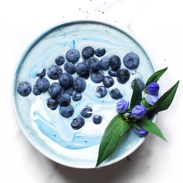 """Who wants a """"naturally"""" ocean blue smoothie bowl?  -------------------------------------------- For the smoothie:  1 frozen banana  1/2 cup almond milk (or your choice of milk)  1/2 teaspoon naturally blue spirulina  1/2 cup natural yogurt  Blend all the ingredients in a blender and top with a bit more yogurt and blueberries (optional). Have an awesome Tuesday everyone!"""