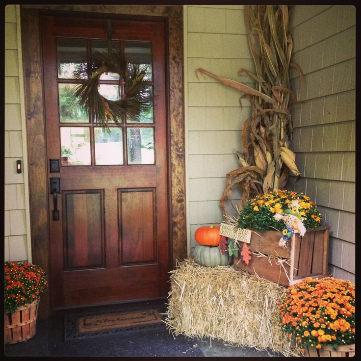 I know this is for fall decor, but I really love the wood front door with the…