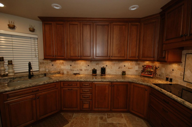 cambria harvest laundry room ideas | StarMark Cherry cabinets with harvest stain and chocolate ...