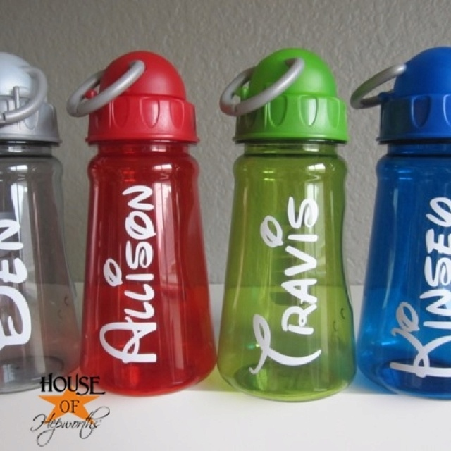 Vinyl stickers on water bottles in a disney font love