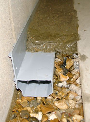 A basement drain system installed in a Modesto home