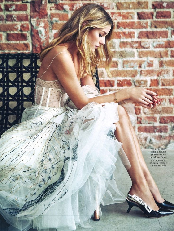 Looking pretty in white, Olivia Palermo wears chiffon Dior dress and heels