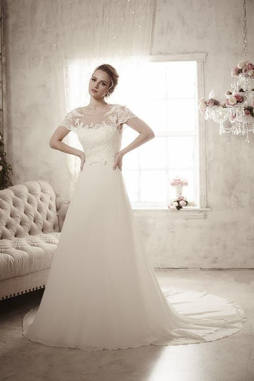 Balletts Bridal - 22860 - Wedding Gown by Jacquelin Bridals Canada - Long flowy chiffon and classy bow waistband give this gown an innocent charm coupled with its short sleeves and sparkling beadwork. Complete with zipperback overlain with buttons and loops. The waistband connects in the back with hook-and-eye latches.