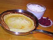 A quick and simple recipe for Pannukakku, the premier oven baked pancake of Finland. Serve with whipped cream and fresh fruit either as a main course pancake or a light dessert.
