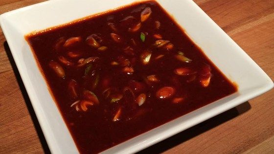 Gochujang sauce, a traditional Korean condiment, is made with soy sauce, sesame seeds, garlic, and other flavors for a sweet and spicy addition to meals.