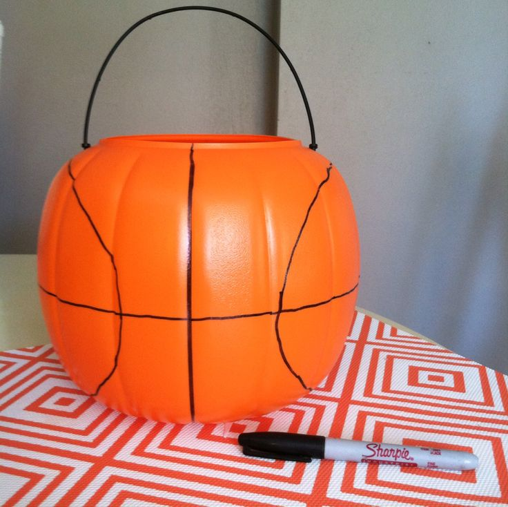 DIY basketball trick or treat bucket using a $1 plastic pumpkin bucket and a sharpie marker. This will be great for collecting candy with my child's basket ball costume!